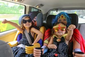 kids embrace superhero car seats