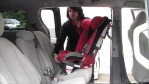 To install the rear-facing car seat using shoulder